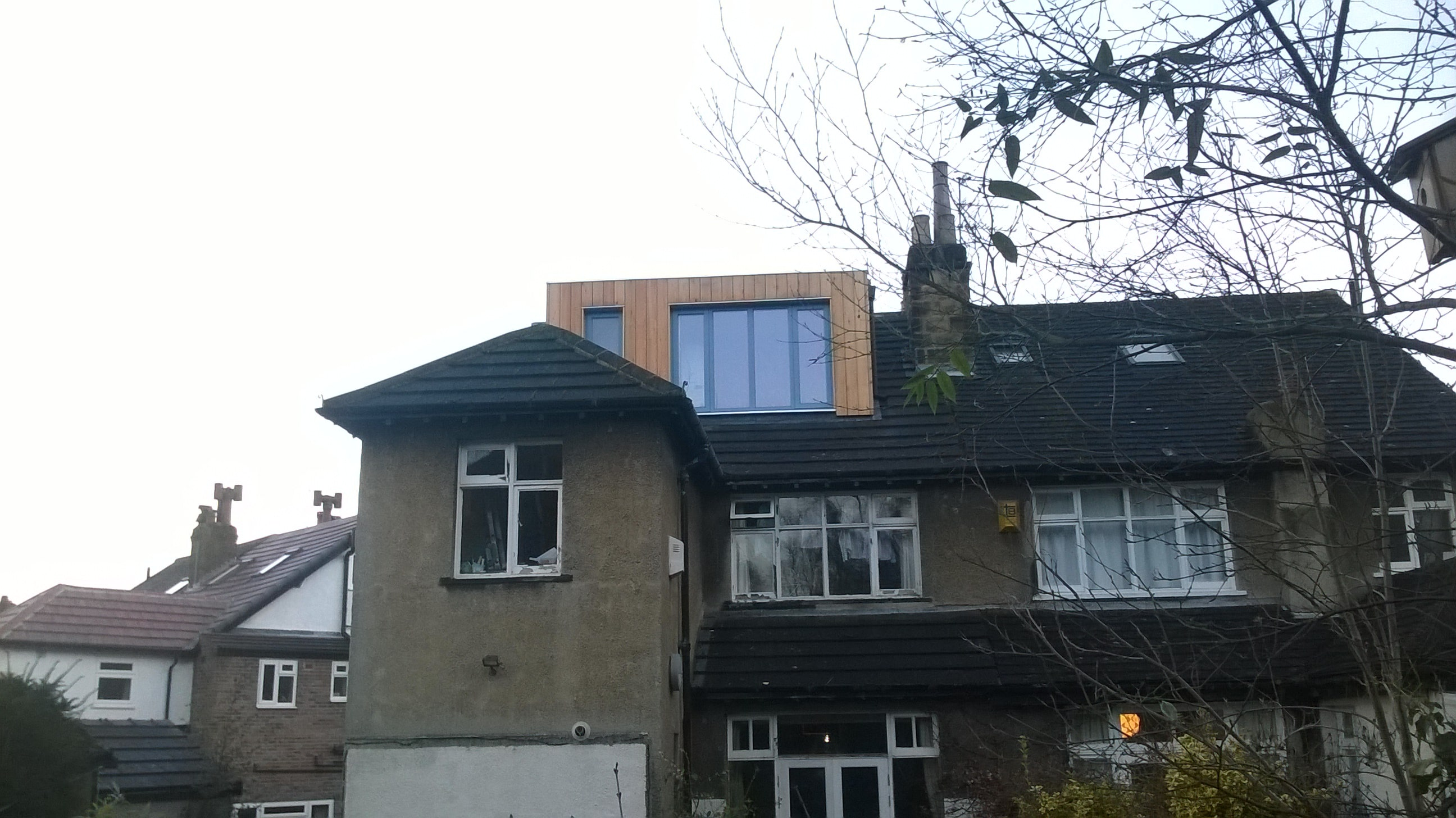 modern dormer on trad 1930s house min